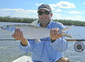 Fly fishing for bonefish this angler shows off a nice sized bonefish caught fly fishing