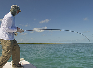 Fly fisherman hooked up on a tarpon in the Florida Keys
